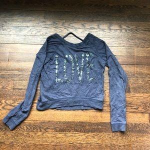Delia 's blue sweater